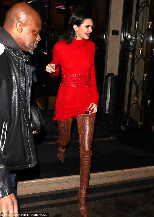 Gorgeous: She upped the glamour thanks to her racy footwear and matched her scarlet lipstick to her dress