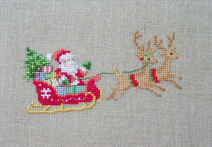 Santa's Sleigh, very well done, I like the fabric pick also.
