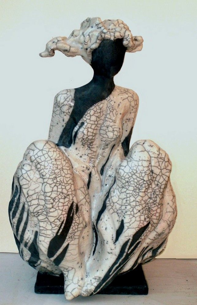 Claude Cavin :raku (I love black and white pottery. Black and white in my living room and green tones for my kitchen)