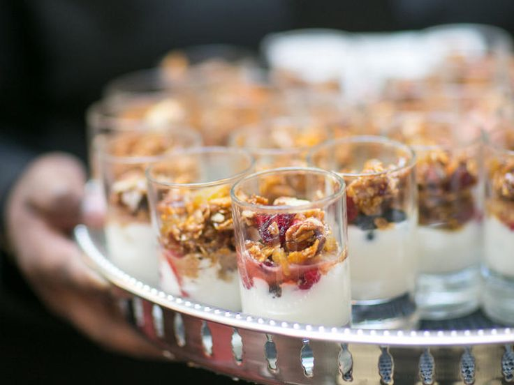 Mini vanilla yogurt and granola parfaits https://www.theknot.com/content/ten-ways-to-serve-brunch-wedding-reception