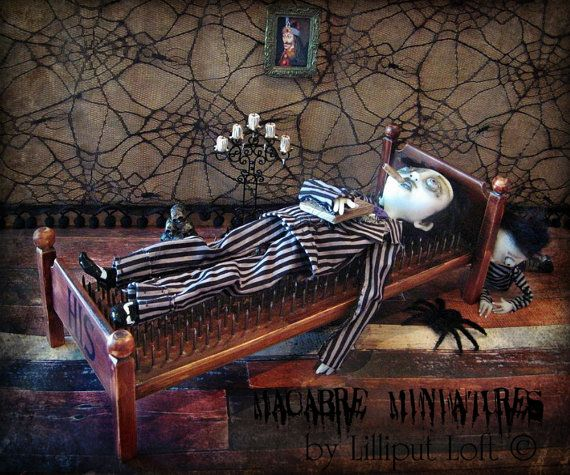 Come, lie down for a spell. Uncle Fester wont mind at all, if you make yourself comfortable on this miniature bed of nails.  Measuring just 355mm (