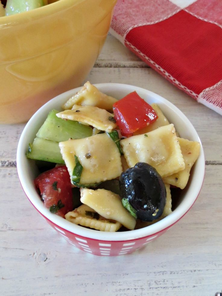 Mediterranean Pasta Salad - A savory cold pasta salad made with cheese ravioli's, cucumbers, tomatoes, fresh basil and a homemade balsamic dressing.