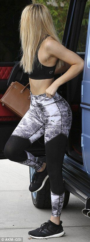 Sporty: Kylie teamed her tight pieces with matching trainers...