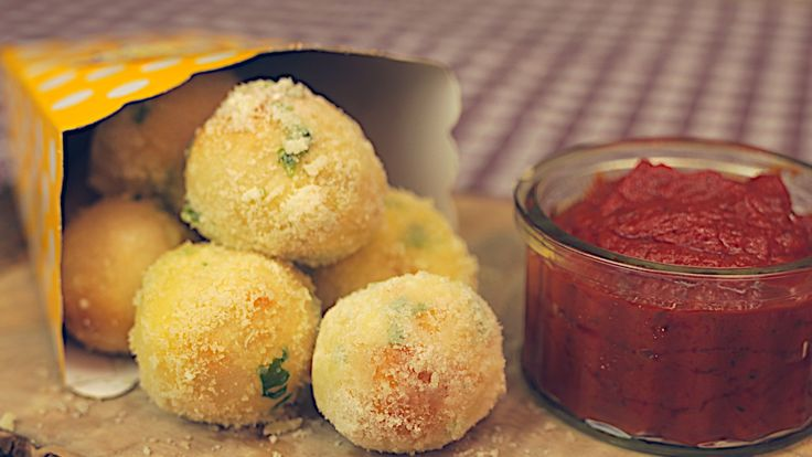 GARLIC PIZZA DOUGH BALLS // What You'll Need: Mini Pepperoni Slices, or Pepperami, cut into little discs Mozzarella, cut into 1cm cubes 500g Pizza Dough 100g salted butter, melted 50g Parmesan, grated Marinara sauce, to serve How You Make It: Preheat the oven to its highest setting. On a work surface, grab a little walnut sized piece of dough, flatten out and pop in a piece of mozzarella and pepperoni. Bring up the sides to seal as best you can, pinching in places....