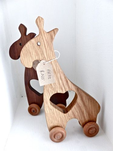 Houtkapper wooden toys available at Bella & Me