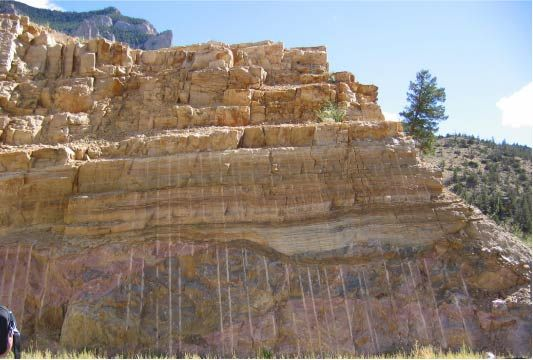 Great Unconformity. The Flathead Sandstone (Cambrian) overlies Precambrian crystalline rocks in this exposure of the Great Unconformity. This unconformity represents approx. 2 Ba of missing time: near Buffalo Bill Dam, WY 2004. Photo: D.Scott Flamm