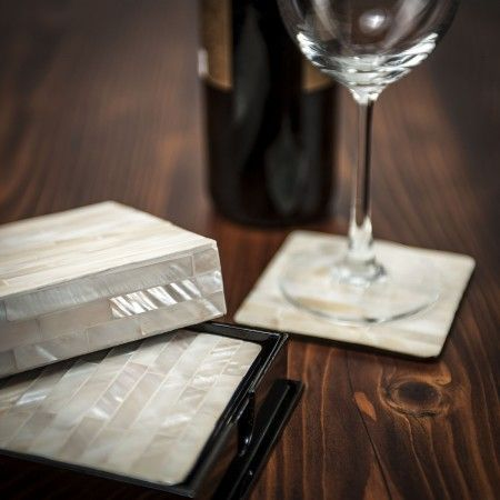 Gift this cream mother of pearl coaster set for a housewarming or wedding to serve those drinks with class.