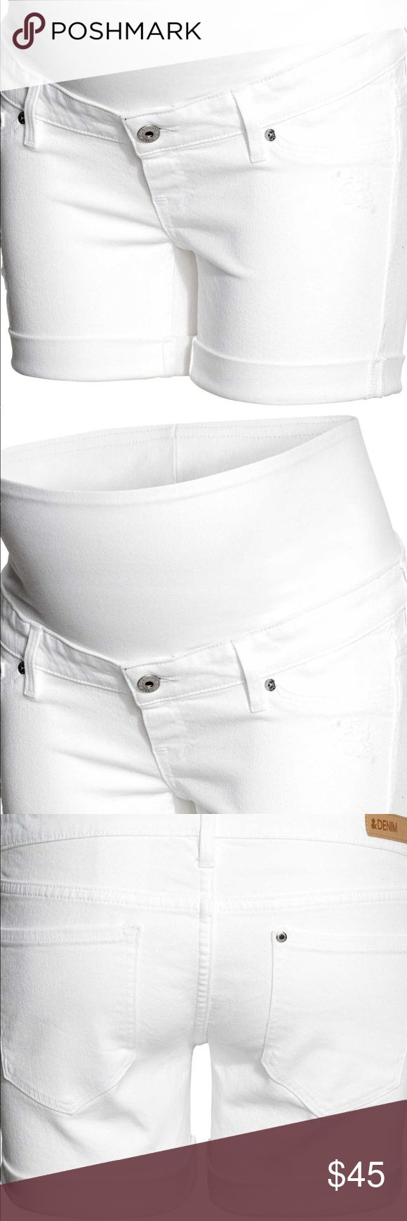 HM maternity white denim shorts Shorts in stretch denim with heavily distressed details. Wide ribbing at waist for added comfort. Mock front pockets, mock fly, regular back pockets, and sewn cuffs at the hems.  95% cotton  5% spandex H&M Shorts