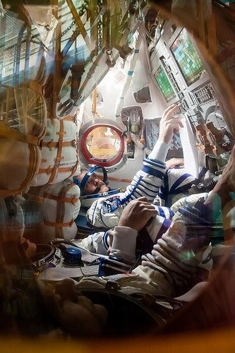 Astronauts inside the vehicle