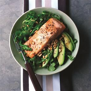 Grilled salmon with rocket, avocado, and pine nut salad