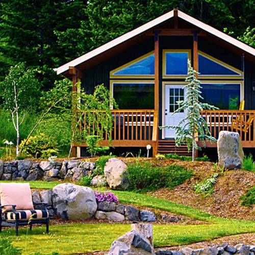 Small Cabins Tiny Houses interiors | Small wood cabin with large windows and beautiful yard landscaping