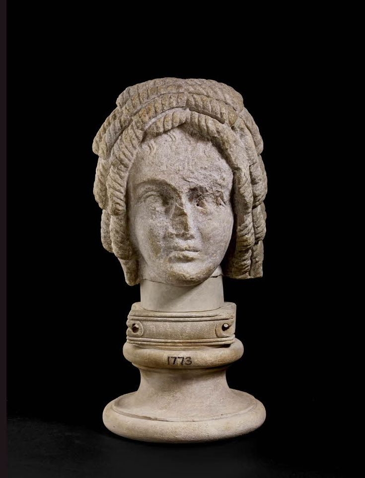 Parian marble portrait head of an African woman with her hair arranged in corkscrew curls.