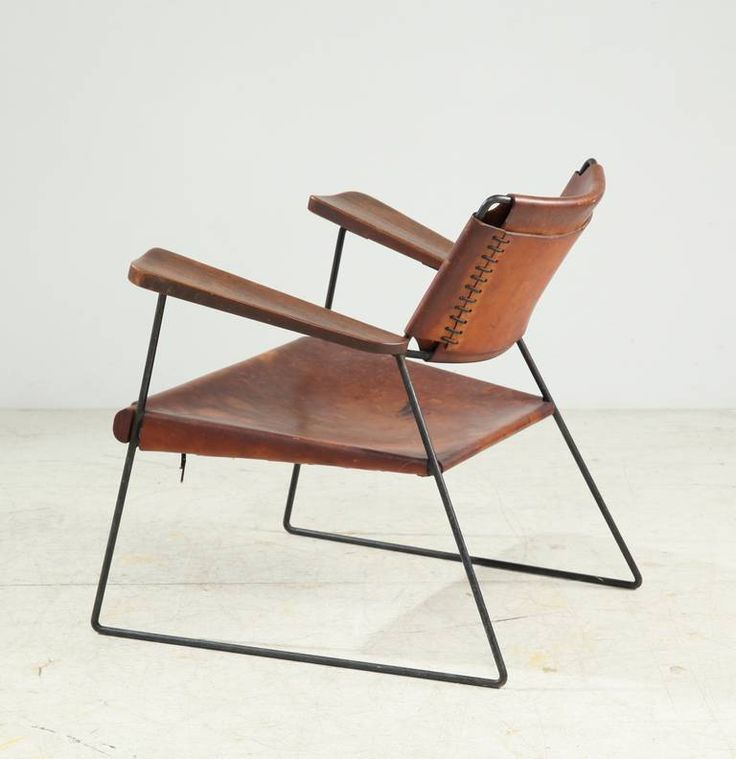 Sam Resnick; Enameled Metal, Wood and Saddle Leather Armchair for Putney Graduate School, 1950s.