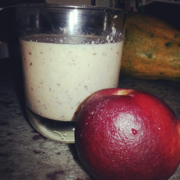 Nectarine yogurt smoothie with coconut oil and flax seed