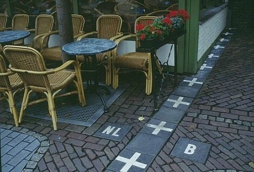 The border between Belgium and the Netherlands in a cafe.