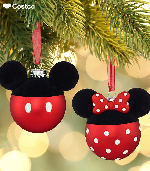 This season combine the magic of the holidays with the enduring love of Disney's favorite couple, Mickey and Minnie Mouse! This glass ornament set by Hallmark features the pair's classic, red-satin color on bottom while the top showcases their famous mouse ears in fuzzy, black velvet. Minnie's bow and glass body are accented with her signature polka dots in sparkly, white glitter. True to form, Mickey's stylish pants are also accented with sparkly, white glitter buttons.