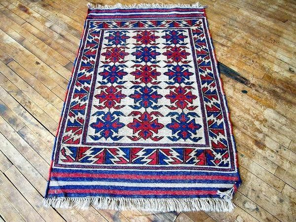 This is Kennedy. She's a very bold 50 year old vintage Persian Kilim rug. Now, close your eyes and imagine her beautiful pattern on your bathroom or bedroom floor. Her blue, light gray, and red color