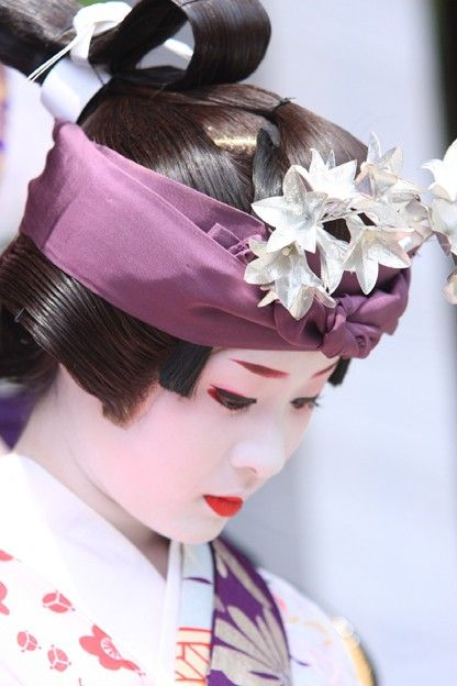 Maiko dressed for Gion Festival in Kyoto, Japan. The Gion Festival (祇園祭) takes place annually in Kyoto and is one of the most famous festivals in Japan. In 970, it was decreed an annual event and has since seldom been broken. It goes for the entire month of July and is crowned by a parade, the Yamaboko Junkō on July 17 and July 24. It takes its name from Kyoto's Gion district.