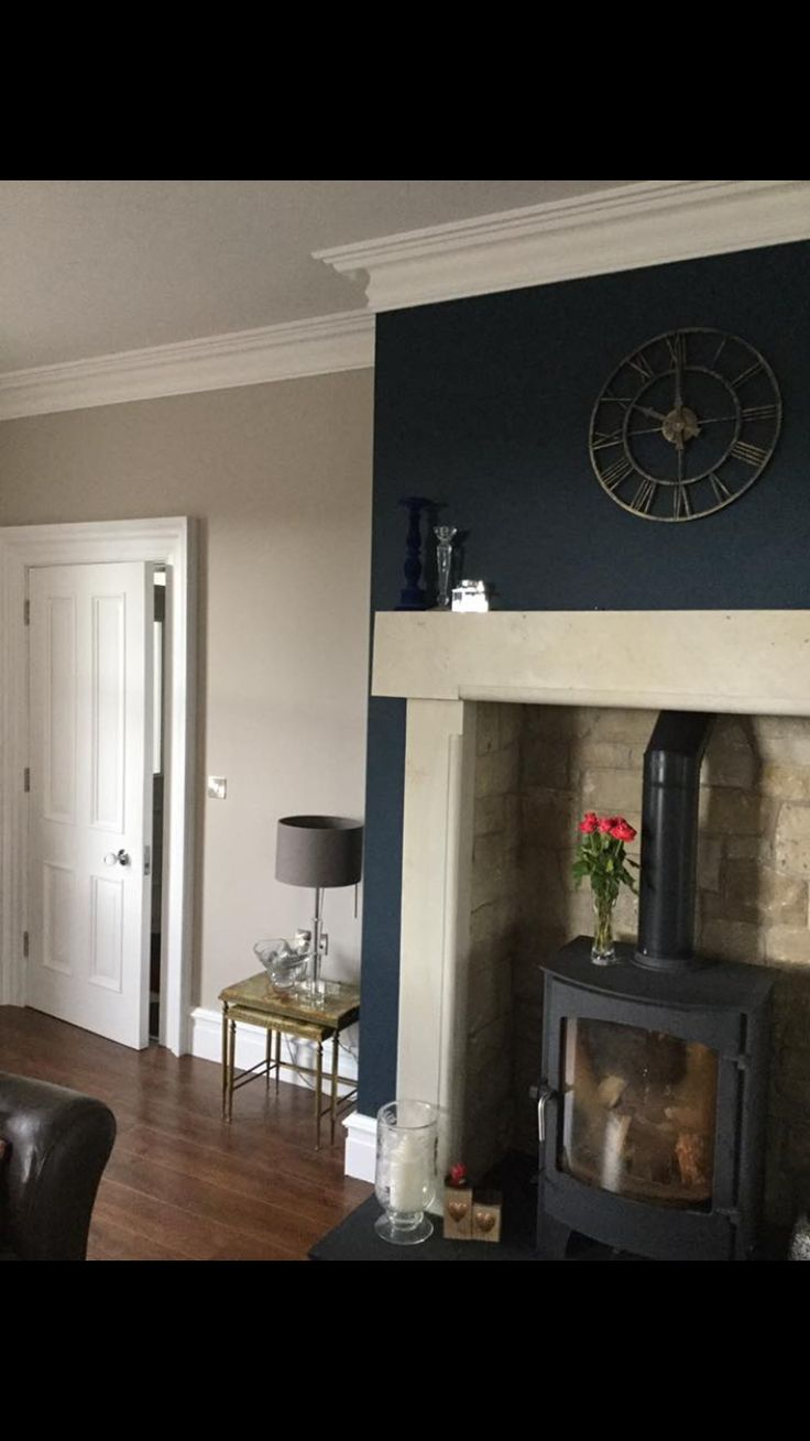 Living room painted in Hague Blue and Elephant's Breath (both Farrow and Ball)