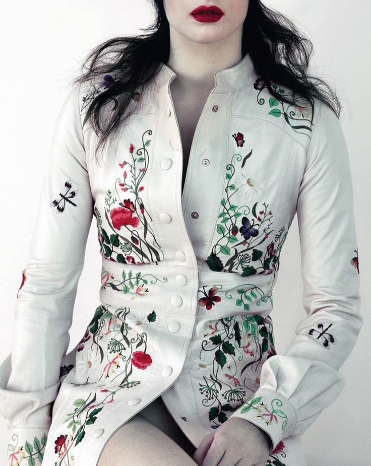 Andraste with an embroidered white/silver leather coat to show her family line.  by Louis Vuitton