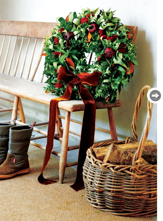 """Country rich wreath uses red in judicious hits – from dried pomegranates to hypericum berries and celosia – set off by a plentiful base of bay laurel, boxwood and magnolia leaves.  The brown velvet ribbon plays off the suede-like texture of the celosia and the rusty-hued backs of the magnolia leaves.  From  """"Style at Home"""". -- Eve.: Christmas Wreaths, Holiday Wreaths, Bench, Country Christmas, Brown Velvet, Holidays, Country Wreath, Christmas Decor, Merry Christmas"""