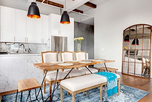 Most of the design work occurred in the kitchen and called for connecting the island to the L-shaped counter, adding a significant pantry build-out near the fridge, and refinishing storage and prep spaces with beautiful materials.