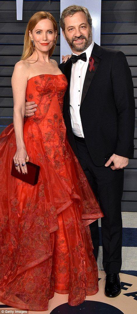 Starry affair: Charlie XCX (left) modeled a backless black split dress, whilst Leslie Mann...
