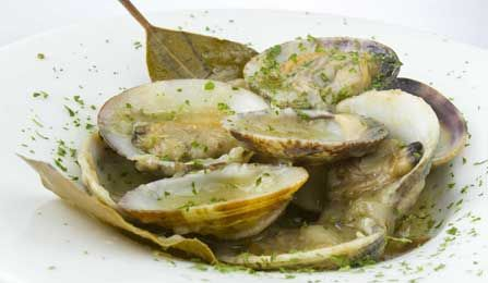 Spanish tapa. Clams in sherry sauce  (Almejas a la marinera). #wine match: Whether raw or cooked, an excellent escort for a clam is always a white Albariño, from the Rias Baixas, with its flowery, citric freshness.