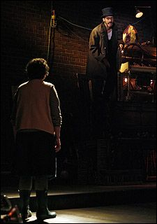 Jayne Houdyshell as Coraline and Elliot Villar as Mr Bobo in the original 2009 off broadway cast of Stephin Merritt and David Greenspan's musical adaptation of Neil Gaiman's Coraline.