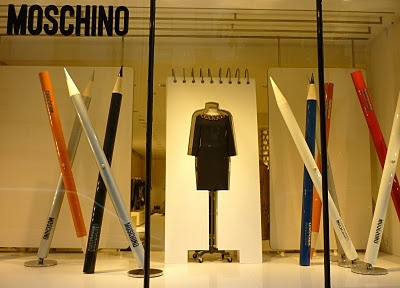 drawing board theme with 3d cutout frame & oversized pencils, moschino
