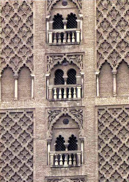 A view of the south face of the Giralda, shows the delicate tracery and traditional double windows of original Almohad design. The balconies were later additions.