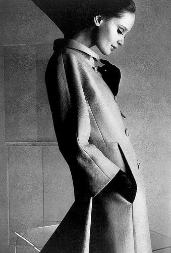 Celia Hammond in Balenciaga's flame-red twill coat with fly-away pleating, photo by David Bailey for Vogue UK, 1967