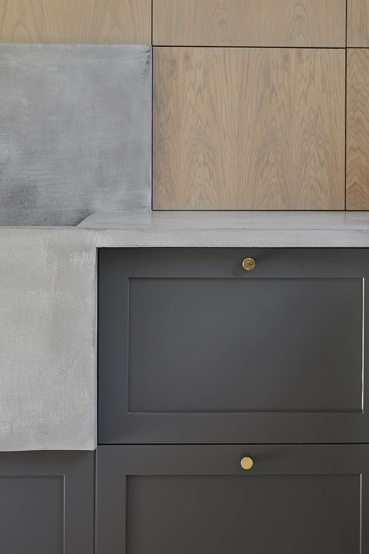 Custom-made kitchen. Concrete countertop, oak and MDF cabinet doors. Designed by Sander Forbes Rolfsen