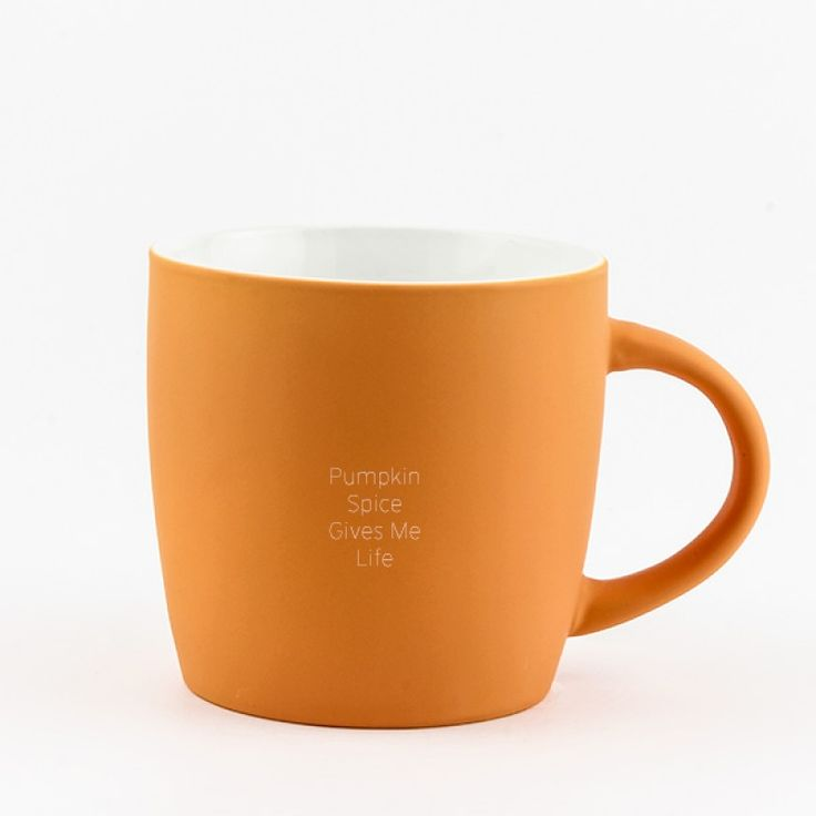 """Orange Velvet Mug 18oz - This ceramic mug is a lovely colour of orange. The exterior is hand sprayed with an orange """"velvet"""" like finish. You will love the way it feels. By adding an engraved message you will make it one of a kind."""
