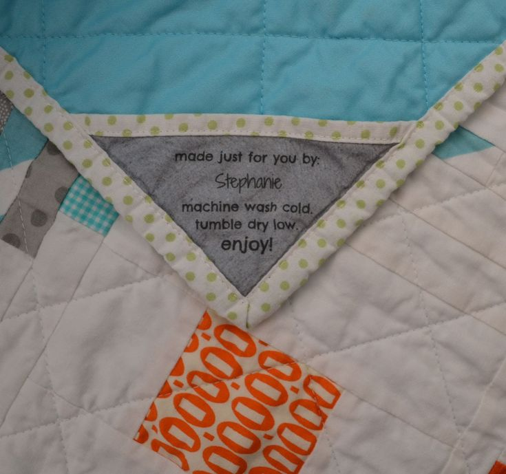 stephjacobson: Finish the bias edge with the same fabric as the binding. Then tuck the other two sides into the corner before applying the binding. Hand-stitch the long edge down.