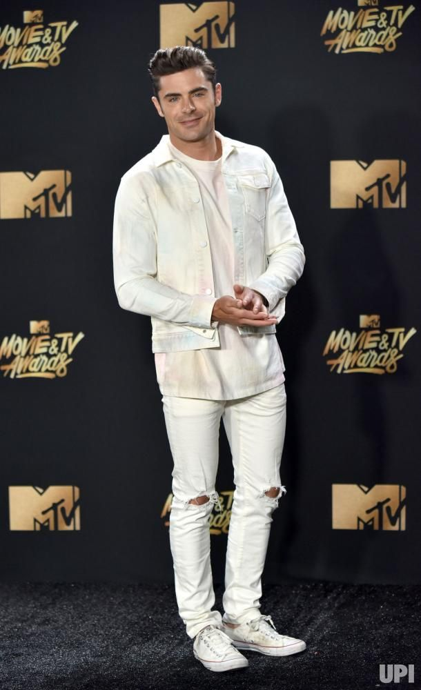 Actor Zac Efron attends the MTV Movie & TV Awards at the Shrine Auditorium in Los Angeles on May 7, 2017. It will be the 26th edition of…