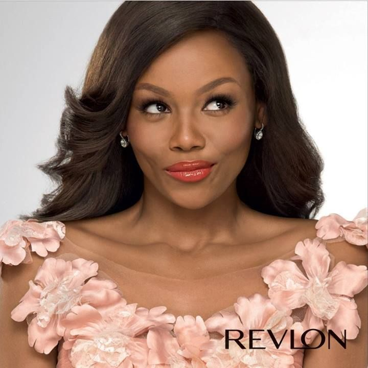 Revlon South Africa Brand Ambassador Bonang Matheba wearing Super Lustrous Lipgloss in 'Kiss Me Coral'.