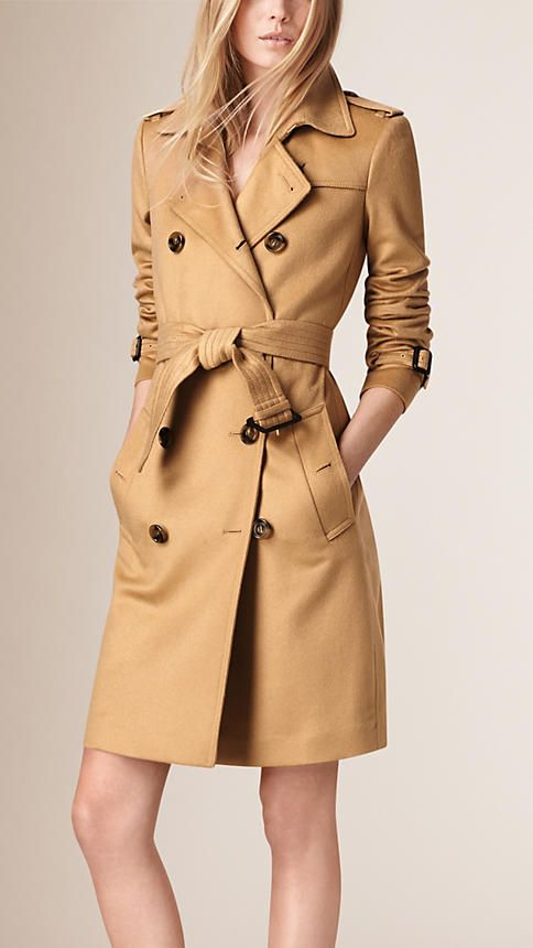 Burberry Kensington fit trench coat in Italian-woven cashmere. The unlined design is tailored with a tapered waist and can be worn belted for a close fit or open and relaxed. Heritage details include a storm shield and check under collar. Discover the women's outerwear collection at Burberry.com