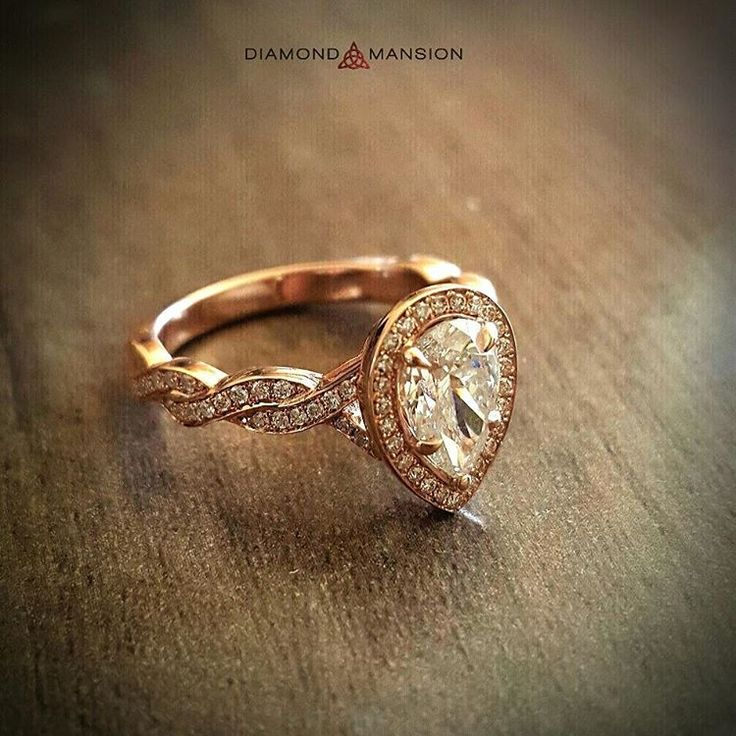 An elegant pear-shaped diamond sits in a rose-gold setting with twisted band. You can have this ring too when you custom design your own version with Diamond Mansion!