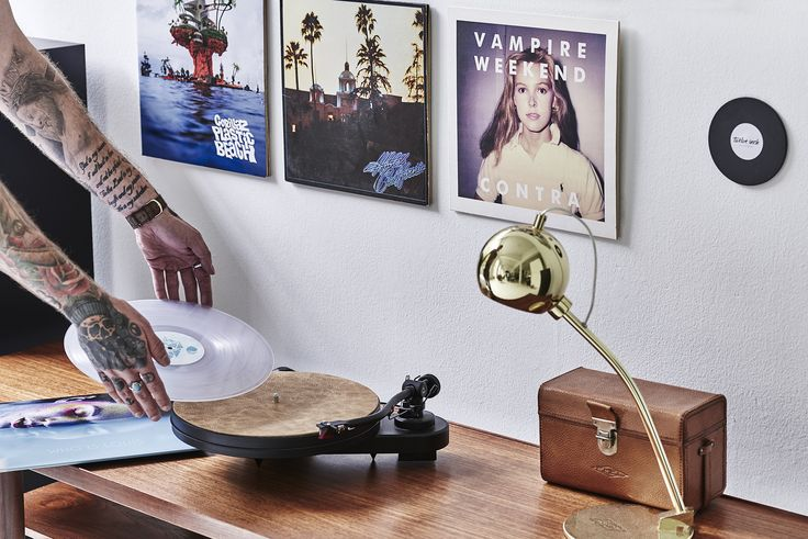 Implementing vinyl record art work into your living room is a great way of expressing your personal taste in music. The atmosphere of the room will completely change depending on the album covers you choose to display. Here, the albums are mounted to the wall with Twelve Inch. Visit our website to read more and get inspired! #vinylonyourwall #tattoo