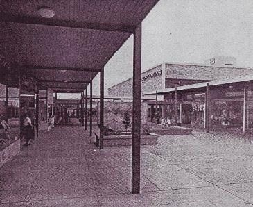 """Sydney's 169,000 square foot TOP RYDE DRIVE-IN CENTRE was Australia's second open-air shopping mall. It originally featured forty-five shops and a four hundred space car park. The anchor was a Sydney-based A.J. Benjamin (rebranded by Grace Brothers in 1964). Costing 1 million dollars, the complex sat 12 miles from downtown. Its slogan...""""Come as you are...shop in comfort"""". Photos 1 and 2 from http://www.ryde.nsw.gov.au"""