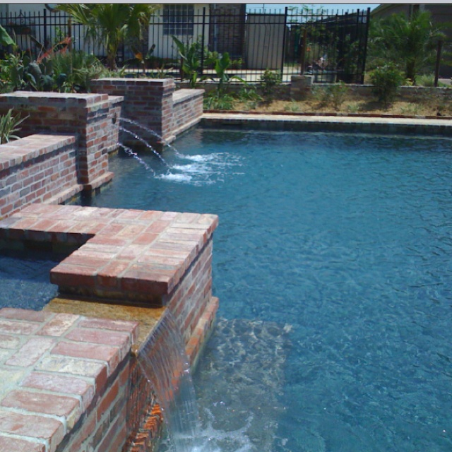 Geometric pool brick coping nola inspired backyard for Pool redesign