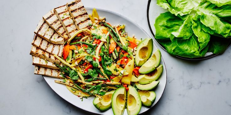 Swap out the traditional green papaya for a summery mix of charred green and yellow wax beans in this refreshing take on Thai salad. The zesty grilled tofu and creamy avocado add filling protein and healthy fats, rounding out the meal for a delicious weeknight vegetarian dinner.