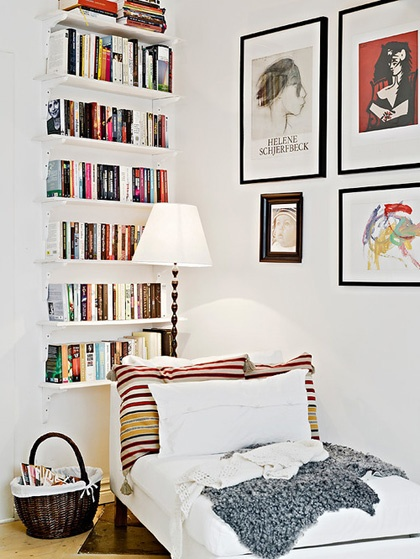 Shallow book shelves installed to the length of the wall