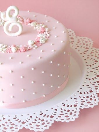 Love the simplicity of this cake & the doily underneath adding extra elegance