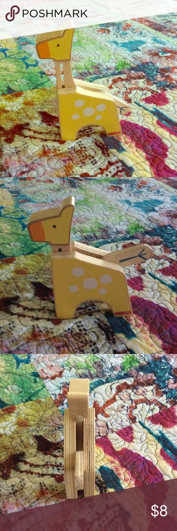 Giraffe Baby Toy 🌼 Skip Hop wooden giraffe with adjustable neck. Tail has been chewed on slightly, otherwise great condition! Great item to bundle with and get 20% off! Skip Hop Other