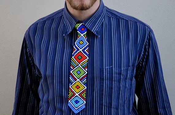 Beaded Mini Necktie African tribal pattern by akwaabaAfrica This is a hand beaded African mini necktie. I am sure that it will add a humorous and fun African touch to lighten up your outfit for a party or even lighten the mood in the office day to day.