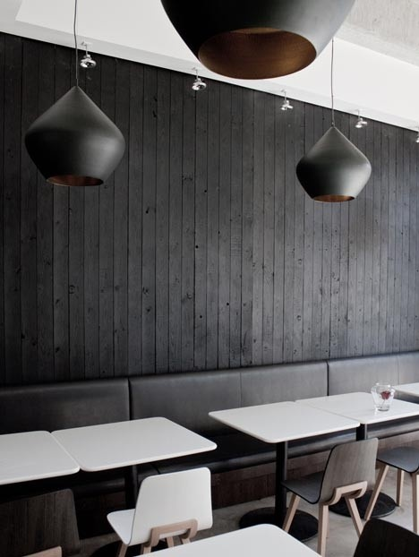 Vertical timber panel wall and pendant lighting