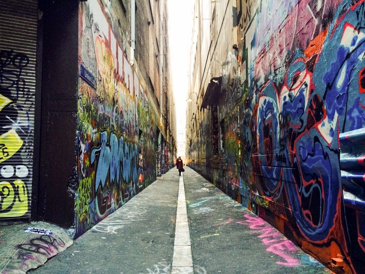 Graffiti-lined alleyway, Melbourne City Center, April 2015. Melbourne is known as a city of the arts, and street arts is no exception, allowing artists to express themselves thru a feast of color, ideas and energy at approved outdoor locations throughout the city providing creative ambience to locals and visitors alike.