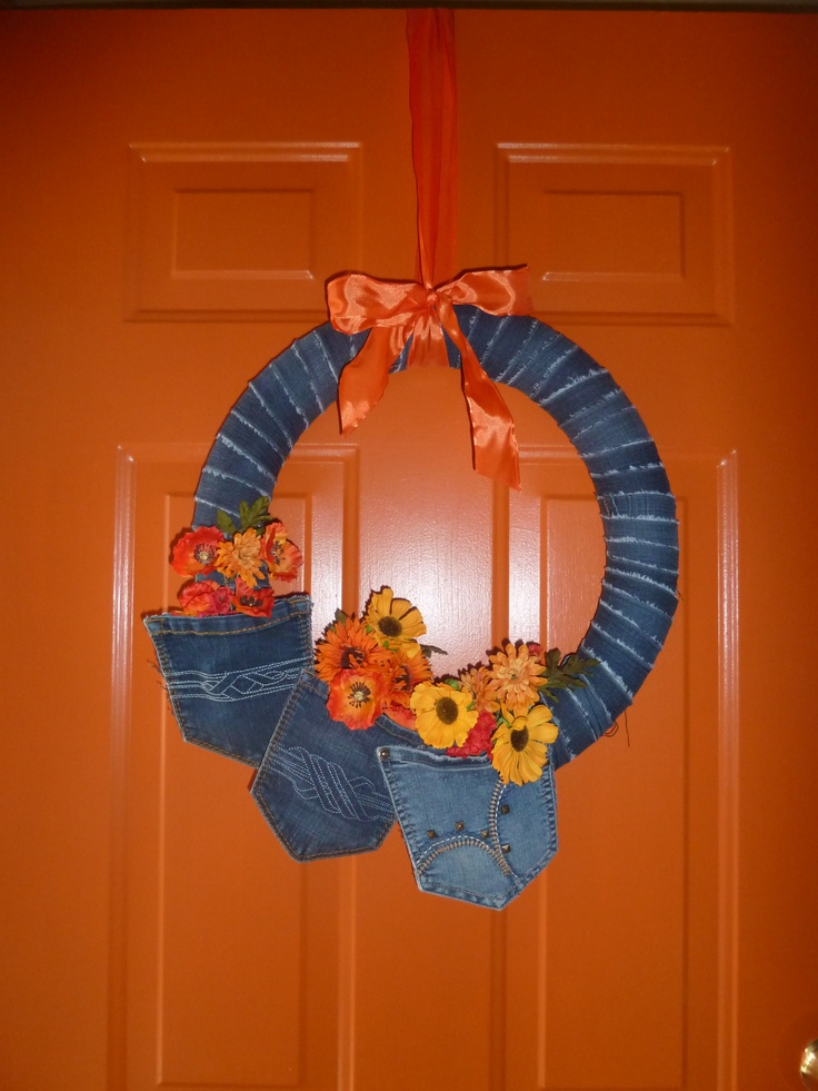 I made this wreath using a pool noodle for the base of the wreath and old blue jeans to decorate it.
